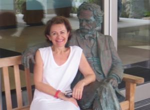 Sandy Cares with the infamous bronze Mark Twain statue in Hamilton, Bermuda