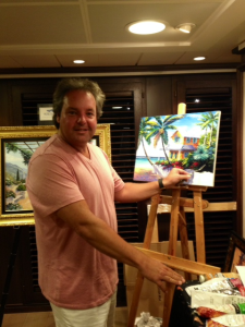 Graham at work in Artist Loft during a recent voyage aboard Riviera