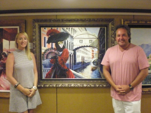 Graham and his wife with one of his vivid Venetian paintings
