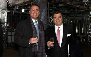 Bob Binder and Frank Del Rio enjoy the first toast onboard Marina.