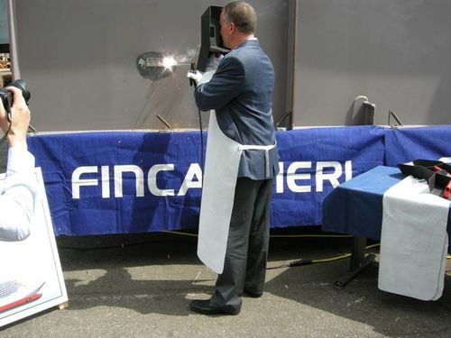 Bob Binder welds the coins into the keel of Riviera.
