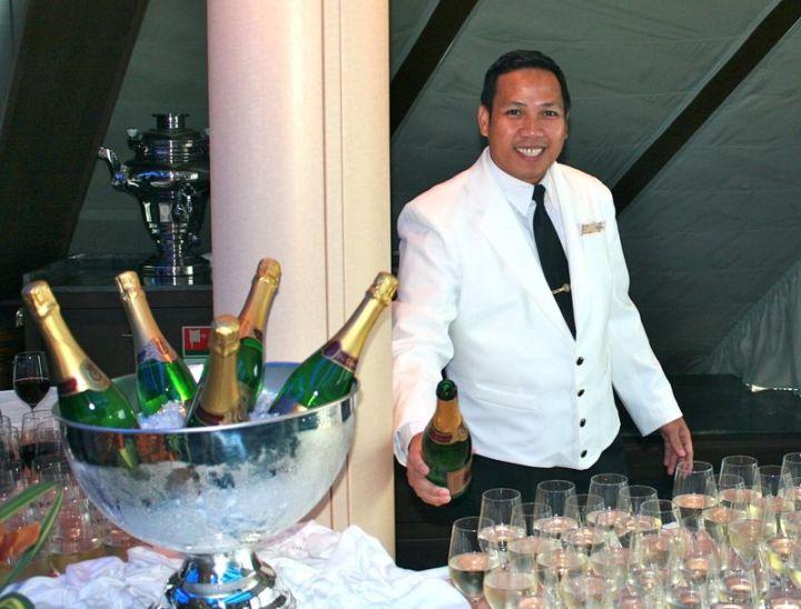 Carlito Pours Champagne